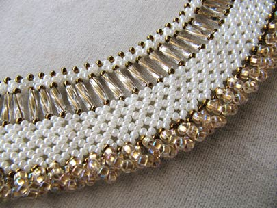 Ceylon pearl with shimmering bronze loops