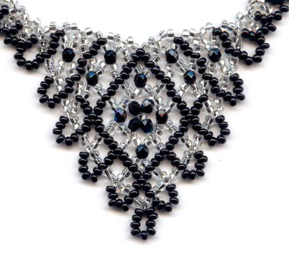 Same Pearl Drop Crystal 'V' - choose your favorite finish on blue